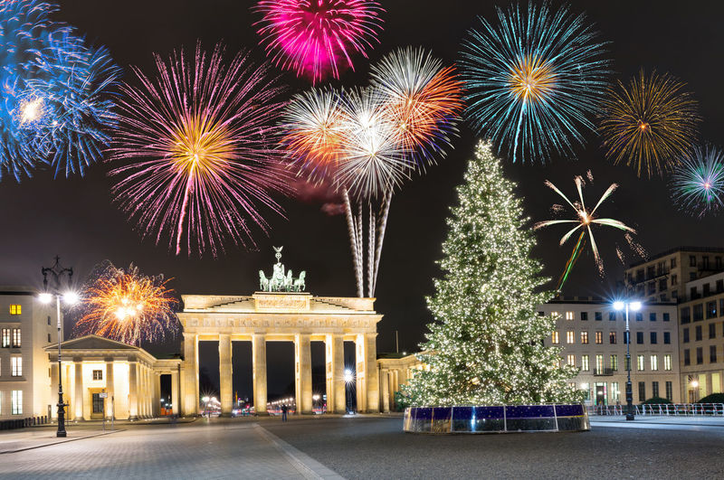 Brandenburg Gate in Berlin, Germany, with fireworks and Christmas tree Architecture Built Structure Celebration Christmas Christmas Tree City City Gate Cityscape Colors Exploding Firework - Man Made Object Firework Display Germany Illuminated Landmark New Year Night Sky Travel Tree