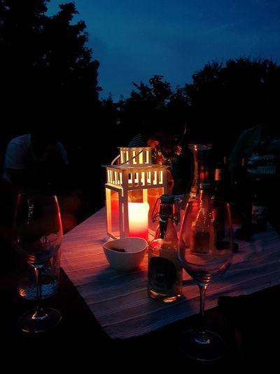 Illuminated restaurant on table at night