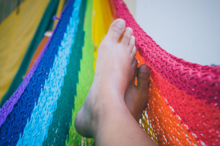 Image view of feet laying on colorful of hammock. Activity Close-up Colorful Eye4photography  EyeEm Best Shots Feet From My Point Of View Fun Hammock Holiday Human Leg Lifestyles Outdoors Part Of People Photography Relax Rope Summer Views The Best From Holiday POV Weave Women Our Best Pics Summer Memories Spring/summer2016