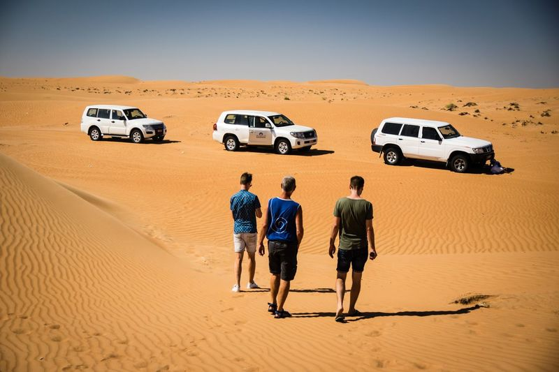 EyeEm Selects Transportation Mode Of Transportation Land Desert Car Sand Motor Vehicle Landscape Extreme Terrain Scenics - Nature Nature Sand Dune Environment 4x4 Journey Climate Travel Holiday Men Arid Climate