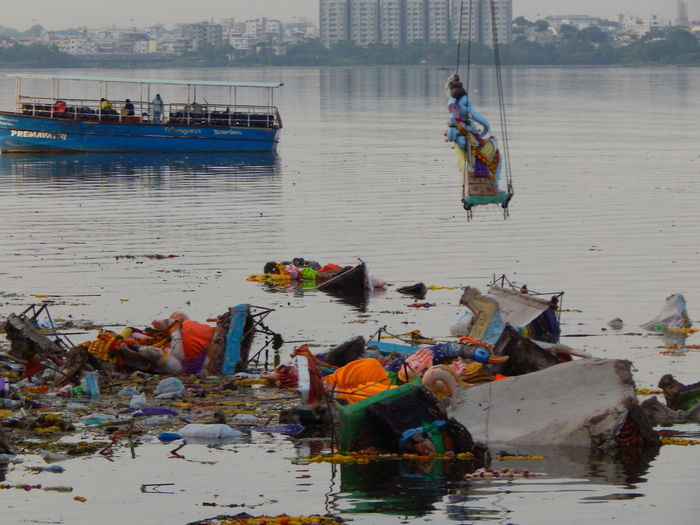 Abandoned statues and garbage in sea