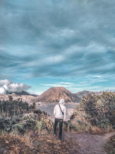 Rear view of man standing at bromo-tengger-semeru national park