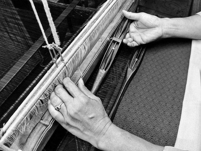 Close-up of person hand working at textile industry