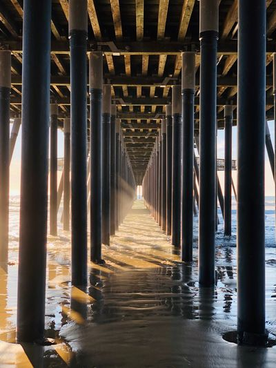 EyeEm Selects Architectural Column Architecture Built Structure Water Diminishing Perspective The Way Forward Direction Pier Underneath Nature No People In A Row Connection Sea Bridge Below Outdoors Metal Day Colonnade