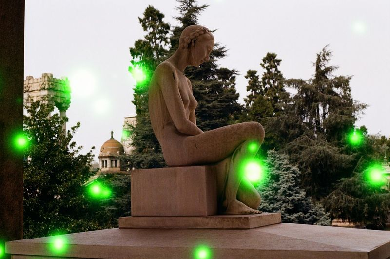 Architecture Art And Craft Belief Built Structure Creativity Green Color Human Representation Illuminated Male Likeness Nature No People Plant Religion Representation Sculpture Sky Spirituality Statue Tree