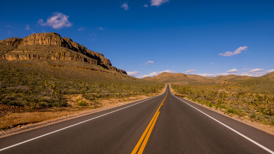 Arid Climate Blue Clear Sky Day Desert Journey Landscape Mountain No People Outdoors Road Scenics Summer Sunlight Sunny The Way Forward Travel Winding Road