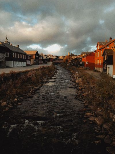Sunset in Norway Cloud - Sky River View River Houses Building Exterior Architecture Sky Built Structure The Way Forward City No People Nature Road Direction Street Cloud - Sky Outdoors Diminishing Perspective Transportation Residential District Illuminated vanishing point