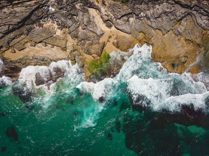 Aerial drone shot of rocky coastline and ocean waves along Australia's coast, Royal National Park, Sydney. Water Motion Sea Nature Outdoors Day Wave Flowing Water Rock High Angle View Power In Nature Royal National Park Sydney Australia Coastline Coastline Landscape Hiking Adventures Drone  Drone Photography DJI Mavic Air Birds Eye View Sunlight Rock Formation Power Turquoise Colored