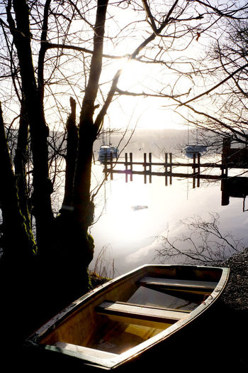 Bare Tree Beauty In Nature Boat Branch Building Exterior Cold Temperature Day Jetty Lake Lake Windermere Mode Of Transport Moored Nature Nautical Vessel Outdoors Scenics Silhouette Sky Tranquil Scene Tranquility Transportation Tree Water Windermere Winter