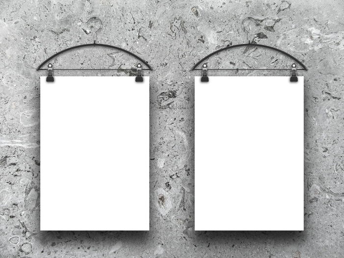 Two blank frames hanged by coat hangers against white marble wall background Coat Hangers Copy Space Picture Frame Wall Architecture Blank Close-up Day Empty Frame Frames Gray Grey Marble Marbledstone No People Outdoors Picture Two