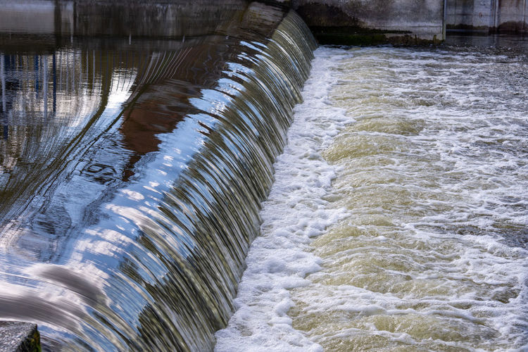 Scenic view of river flowing through dam