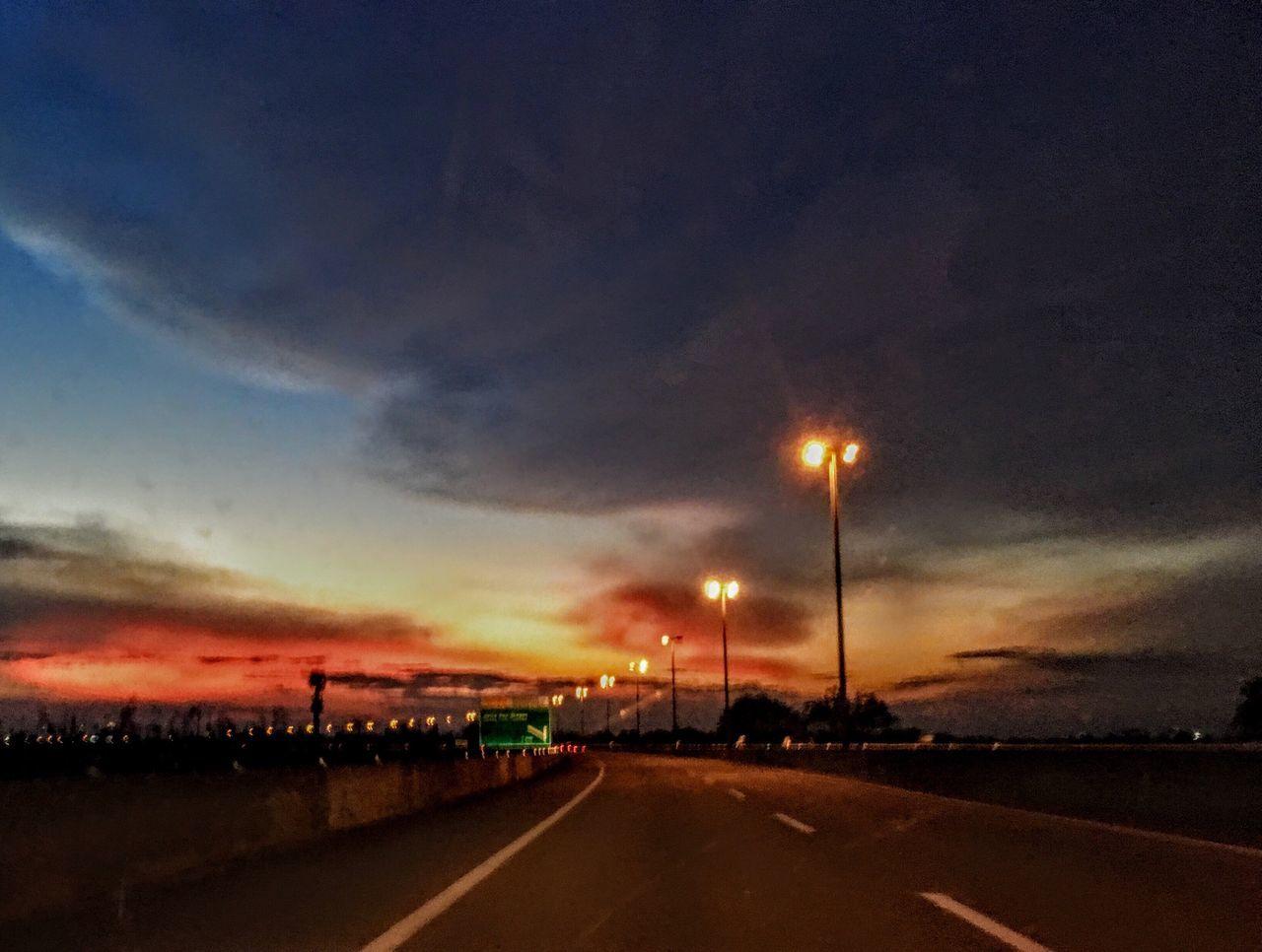 road, the way forward, sky, illuminated, transportation, cloud - sky, street light, sunset, night, outdoors, no people, building exterior, nature, architecture