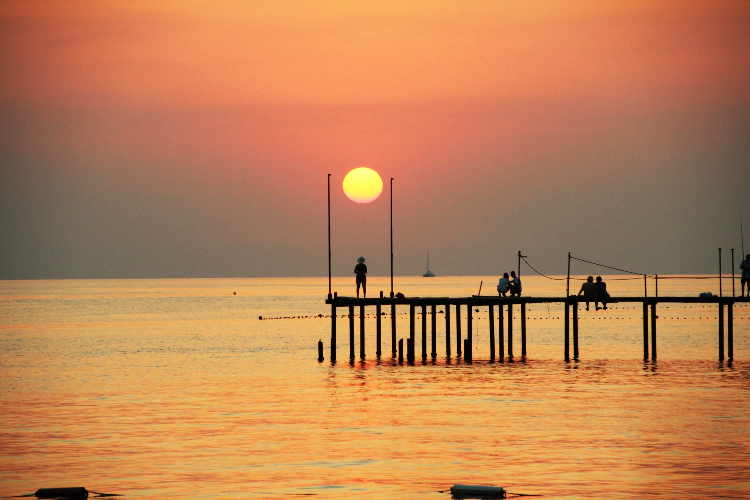 sea, sunset, water, horizon over water, sky, nature, tranquility, beauty in nature, tranquil scene, sun, outdoors, no people, day