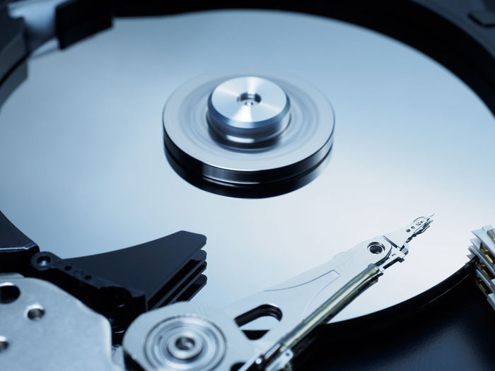 Spinning hard disk drive Close-up Computer Data Drive Electronics  Hard Disk Hardware Hdd Hello World Inside Magnetic Memory Rotation Spinning Storage Technology Close Up Technology Metal Precision Cnc Mirror Reflection Backup