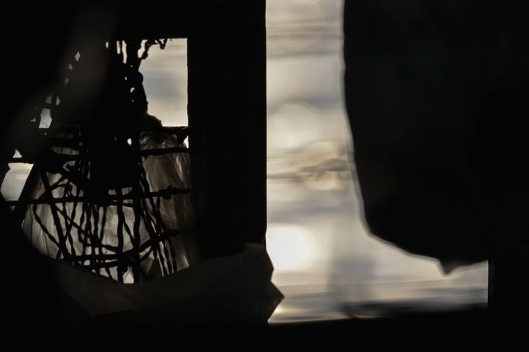 Close-up of silhouette bicycle against window