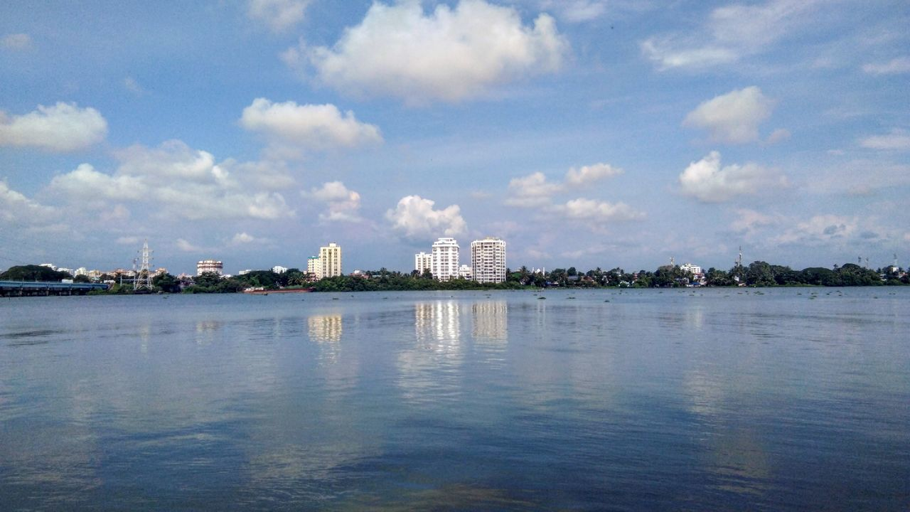 cloud - sky, sky, water, architecture, building exterior, waterfront, built structure, nature, reflection, no people, day, building, outdoors, city, sea, factory, tree, industry, view into land