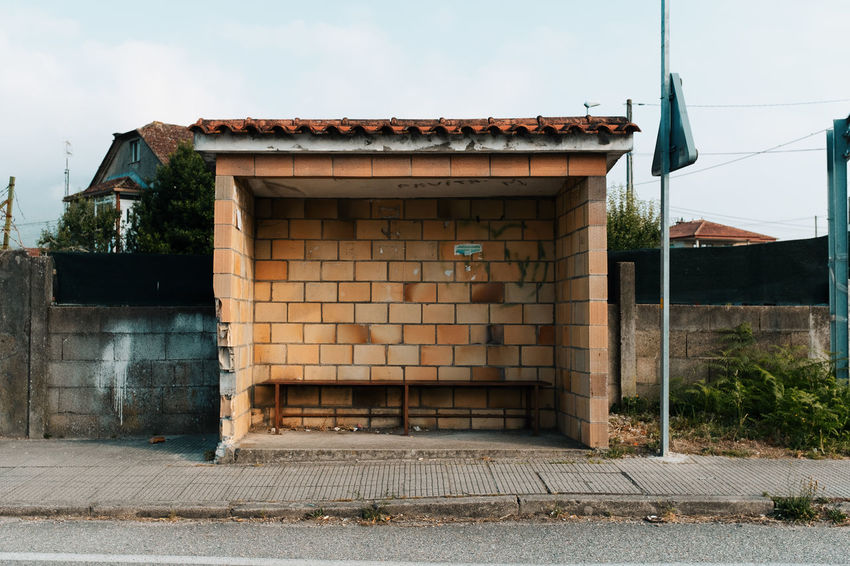 LOST IN GALICIA 🚌 Lostingalicia Threeweeksgalicia Bus Stop Architecture Built Structure No People Day Nature Outdoors Plant Tree Building Exterior Sky Building House Entrance City Door Sunlight Transportation Old Road Street