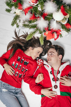 Ornament Ornaments One Woman Only One Man Only Young Adult Young Couple Couple - Relationship People Real People Red Holiday Christmas Clothing Decoration Tree Childhood Females Togetherness Friendship Males  Portrait Reunion - Social Gathering Bauble Christmas Ornament Christmas Decoration Christmas Decorating The Christmas Tree