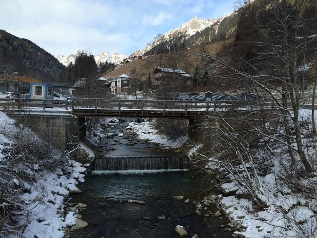 Architecture Bare Tree Beauty In Nature Bridge - Man Made Structure Building Exterior Built Structure Cold Temperature Connection Day Hydroelectric Power Mountain Nature No People Outdoors River Scenics Sky Snow Tranquility Tree Water Winter