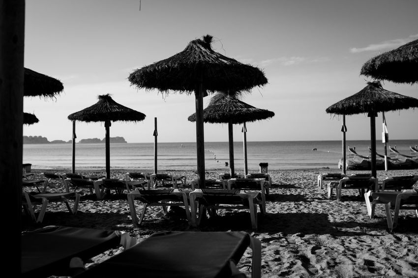 Fourdayspalma Monochrome Nature Outdoors Water Sea Beach Land Horizon Horizon Over Water Sky Thatched Roof Parasol Beauty In Nature Umbrella Tranquility Roof Sand Chair Scenics - Nature Beach Umbrella Tranquil Scene No People