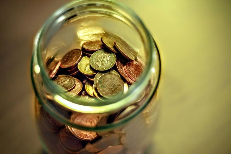 High Angle View Of Coins In Jar
