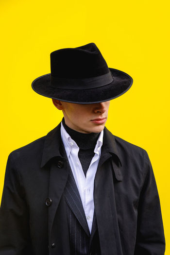London Fashion Week Mens 2019 Redefining Menswear Clothing Hat Suit Front View One Person Well-dressed Formalwear Yellow Young Men Wall - Building Feature Standing Waist Up Young Adult Real People Men Black Color Lifestyles Fashion Menswear Fashion London Fashion Photography Street Style Mensfashion