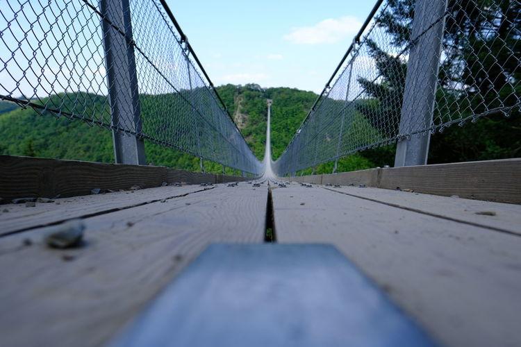 Surface level of bridge against sky