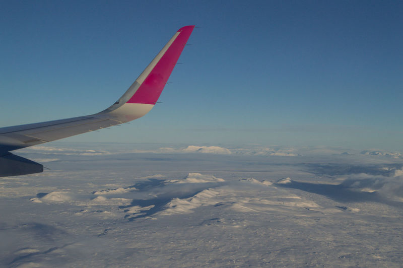 Iceland Europe Ice Snow In Flight Air Vehicle Mode Of Transportation Airplane Flying Aircraft Wing Sky Transportation Cold Temperature Nature Winter No People Scenics - Nature Day Cloud - Sky Beauty In Nature Environment Travel Blue Outdoors Snowcapped Mountain