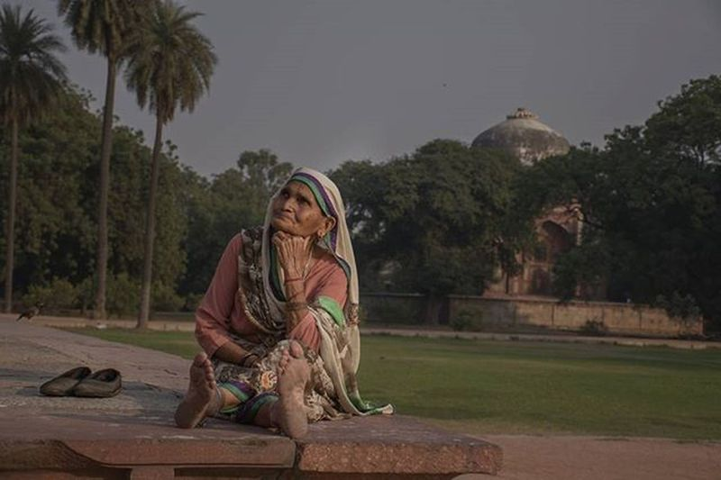 I didn't tell her to pose for  me...but she just did it for some reason, and the elements in this picture like her shoes put besides her and she is sitting there, gives the feeling of relaxation, so i just like it. Streetsofindia Humayustomb Dusk India Incredibleindia Photojournalism _soi Photooftheday Delhi Yehdillihai ShotinIndia DelhiNCR Everydayeverywhere Worldwide ASIA Indiaclicks Sodelhi Yehdelhihai Photography Instagram Instapic Lady Oldwomen Relaxing Relaxation shoes posing
