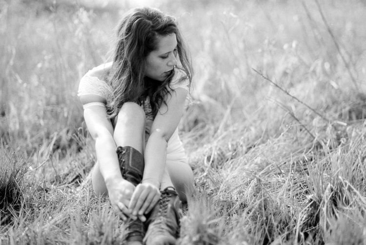 Young woman in grass