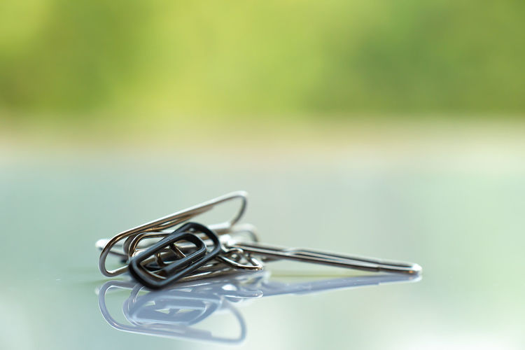 Close-up of paper clip on table