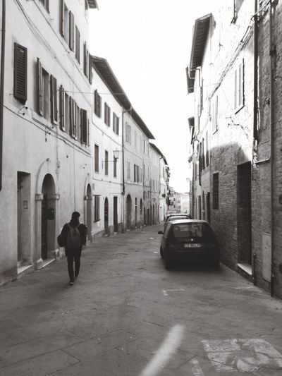 Architecture Building Exterior Street City Walking Road Real People Blackandwhite Photography Streetphotography Streetphoto_bw The Way Forward One Person Italy Streets Of Siena Siena, Italy