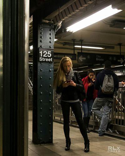 125 Standing Area RLX NYC Street Photographer Fujifilm Xt1 35mm Harlem  Subway 125th St Woman Standing Cell Phone