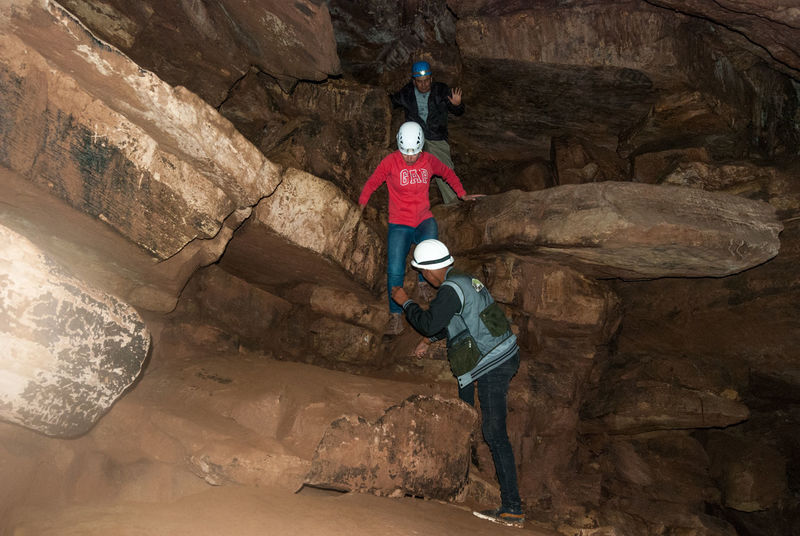 Caving Bolivia Adult Adventure Caving Climbing Day Exploration Extreme Sports Full Length Headwear Helmet Hiking Leisure Activity Nature Outdoors Rear View Rock - Object Rock Face Rock Formation Sports Helmet Standing Torotoro
