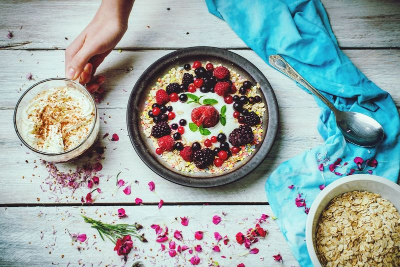 sunny, spring morning, lets eat breakfast Human Hand Breakfast Homemade Fruit Table High Angle View Cake Directly Above Healthy Lifestyle Dessert Chia Seed Granola Berry Fruit Yogurt Raspberry Oats - Food Breakfast Cereal Corn Flakes Oat Flake Red Currant Blackberry - Fruit