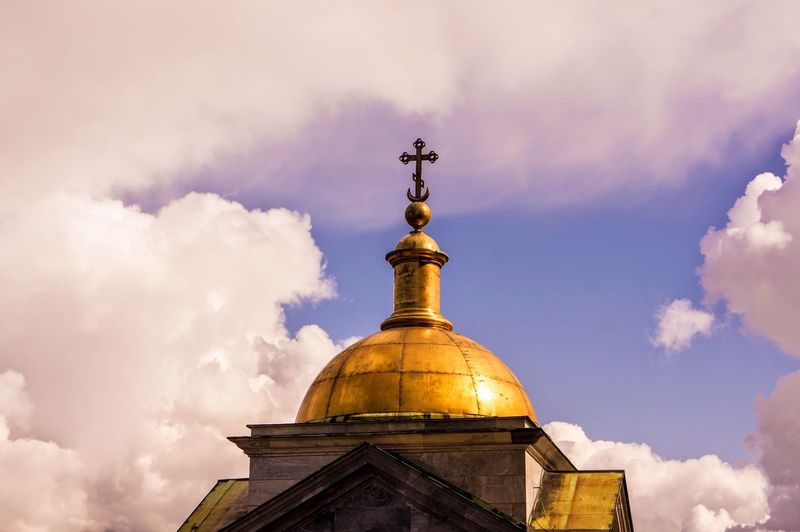 High Section Of Church Against Clouds