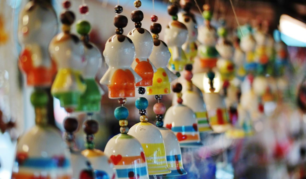 figurine, multi colored, variation, retail, for sale, art and craft, indoors, human representation, large group of objects, close-up, no people, focus on foreground, choice, day, doll