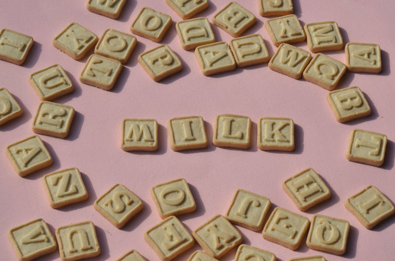 shortbread sugar cookies with letters of the alphabet on each cookie and spelling out the word M I L K Alphabet Close-up Cookies Indoors  Large Group Of Objects Milk No People Ready-to-eat Snack Studio Shot Sweet Food Text Word