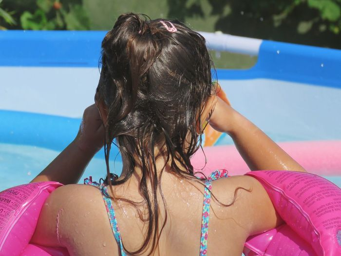 Rear View Of Girl In Wading Pool