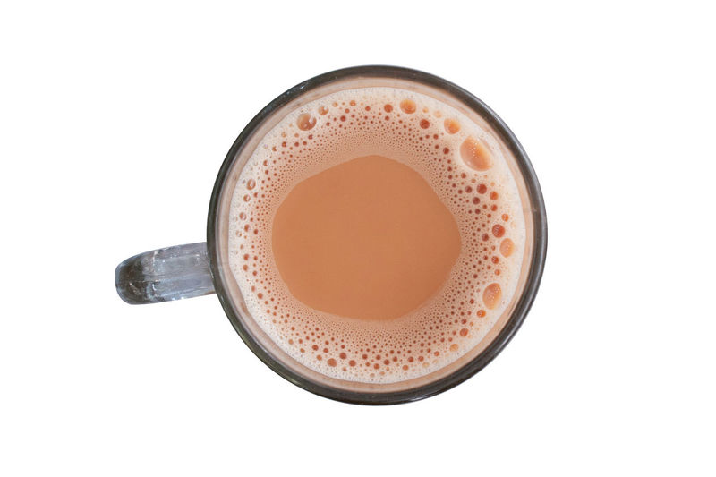 Hot milk tea known as Teh Tarik in a mug isolated over white background view from top. Advertising Beverage Food And Drink Holiday Isolated Teh Tarik Teh Tarik (Malaysian Pull Tea) Travel Bussiness Cropped Cultures Healthy Eating Healthy Lifestyle Indian Food Malaysia Milk Tea People Prata Roti Canai Travel Destinations White Background