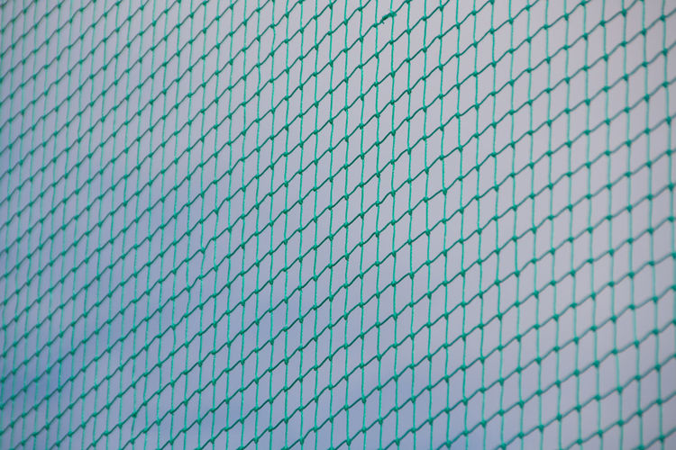 Backgrounds Blue Conformity Day Fence Full Frame Green Mesh Netting No People Pattern Protection Repetition Safety Security Sky Squares TakeoverContrast
