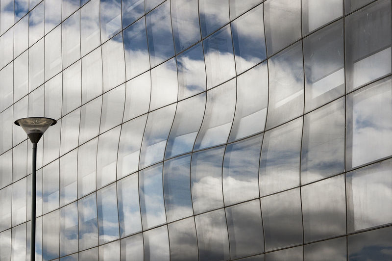 Reflection Of Clouds On Building