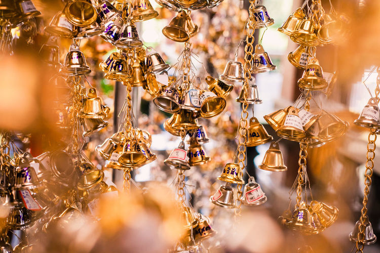 Close-up of bells hanging for sale