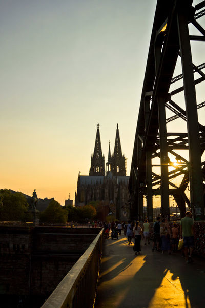 Sunset view of Dom Cathedral and Hohenzollernbrucke Architecture Built Structure Sky Building Exterior Group Of People Transportation Sunset Building Nature Real People City Incidental People Large Group Of People Connection Bridge Clear Sky Belief Travel Destinations Place Of Worship Tourism Outdoors Köln Dom Cathedral Hohenzollernbrücke