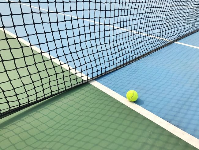 Tennis Sport Court Tennis Ball Tennis Net Net - Sports Equipment Tennis Racket Sports Equipment Ball Racket Sport Leisure Activity Sports Venue Racket Challenge No People Close-up Outdoors Professional Sport Yard Line - Sport Taking A Shot - Sport