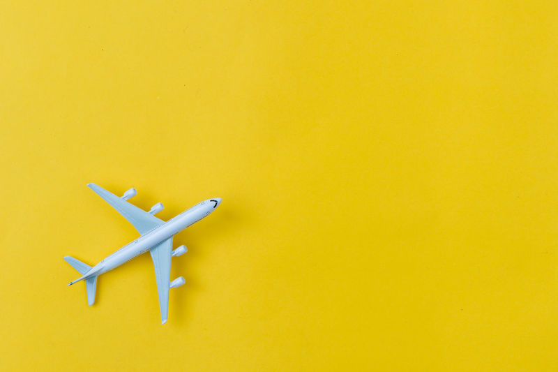 Yellow Copy Space No People Colored Background Airplane Indoors  Air Vehicle Still Life Studio Shot Cut Out Yellow Background Transportation Built Structure Wall - Building Feature Group Of Objects Architecture Art And Craft High Angle View Single Object