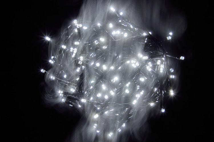 Close-up of firework display over black background