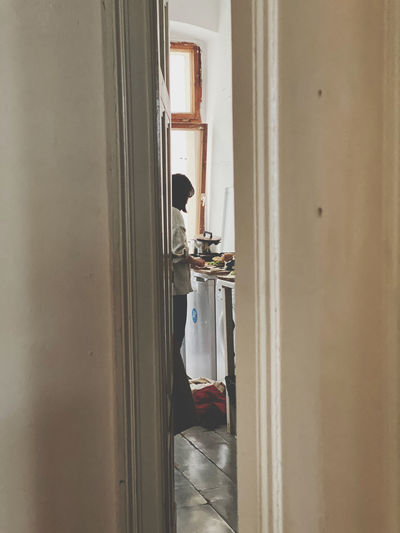 Man standing in bathroom at home
