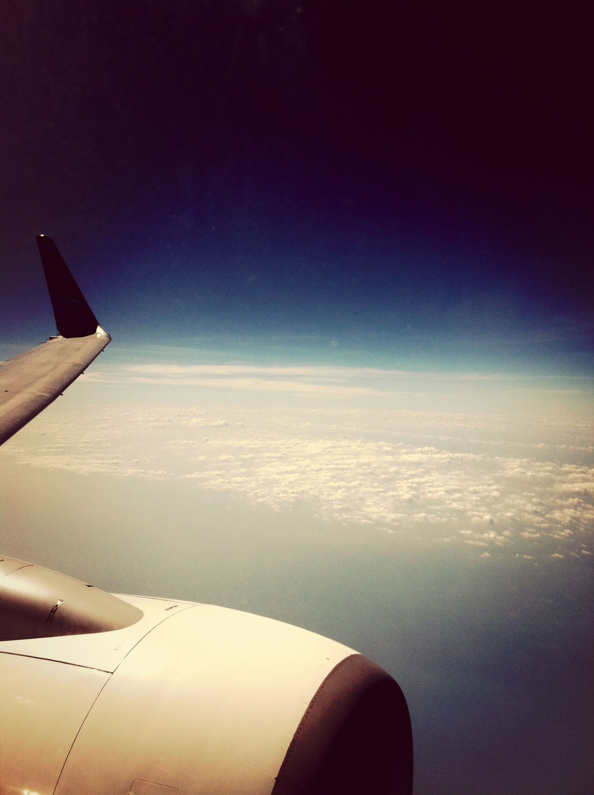 airplane, air vehicle, aircraft wing, flying, transportation, mode of transport, part of, cropped, sky, mid-air, aerial view, journey, travel, airplane wing, scenics, public transportation, landscape, on the move, aeroplane, beauty in nature