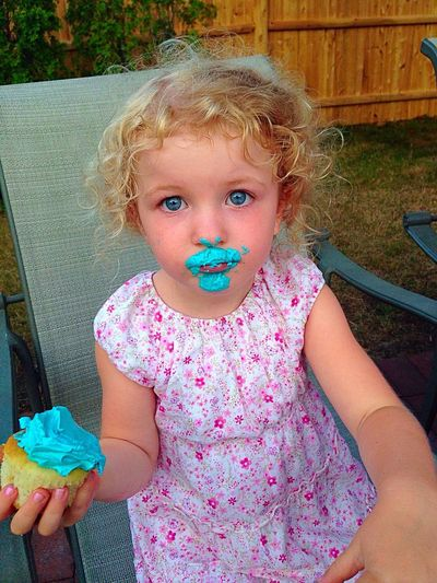 Frosting lipstick to accent her eyes... Enjoying Life Hanging Out Hello World Messy Face Cupcake Funny Funny Moments Big Eyes Blue Eyes Summer Simple Moment Sweet Innocence The Portraitist - 2016 EyeEm Awards Colour Of Life TakeoverContrast Enjoy The New Normal Visual Feast Food Stories